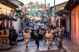 Pilgrims run through the streets of San Cristobal de las Casas after completing the pilgrimage for Dia de Virgen de Guadalupe