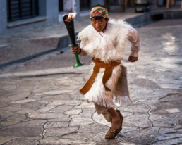 Boy running with a torch