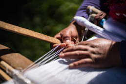 A womans hands weaving in Tenejapa, Mexico