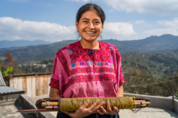 Woman with backstrap loom