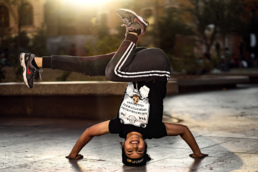Woman breakdancing in the evening