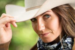 Portrait of woman in cowboy hat