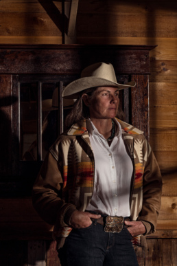 Portrait of a woman in a cowboy hat and dress